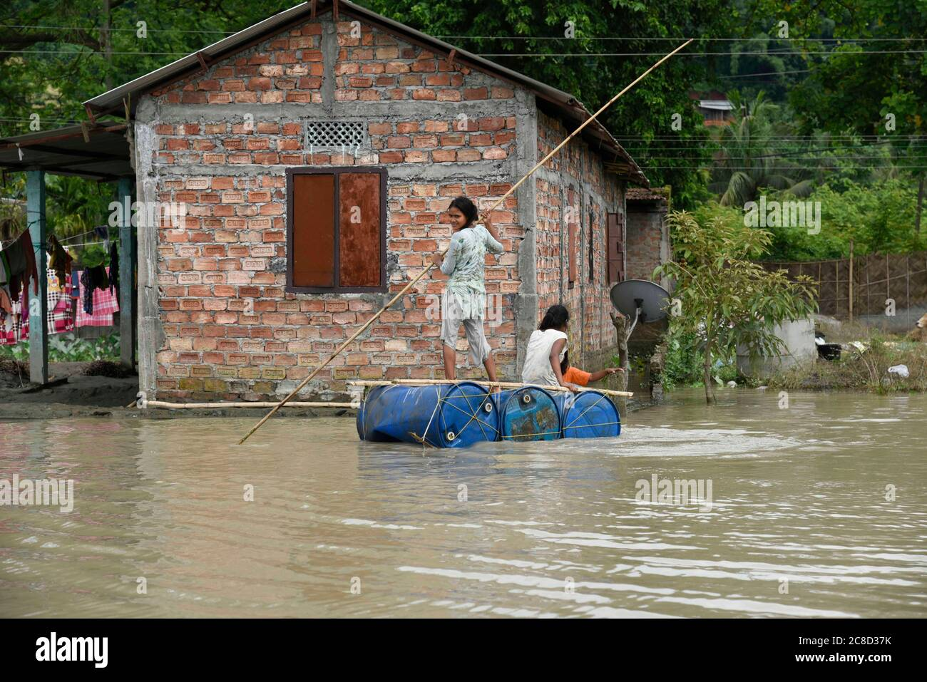 Kamrup, Assam, India. 23rd July, 2020. Girl row a raft in a flood affected village in Kamrup district of Assam. Credit: David Talukdar/ZUMA Wire/Alamy Live News Stock Photo