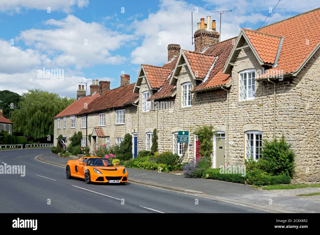 sports-car-in-the-village-of-hovingham-ryedale-north-yorkshire-england-uk-2C8X8R2.jpg