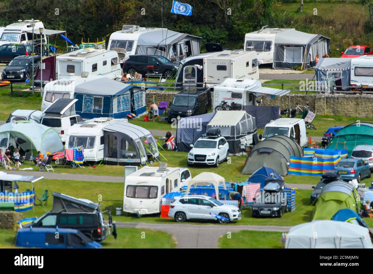Burton Bradstock, Dorset, UK.  1st August 2020.  UK Weather. The camp site at Freshwater Holiday Park is busy with holidaymakers camping in tents, caravans and camper vans at Burton Bradstock in Dorset on a day of hot sunny spells.  Picture Credit: Graham Hunt/Alamy Live News Stock Photo
