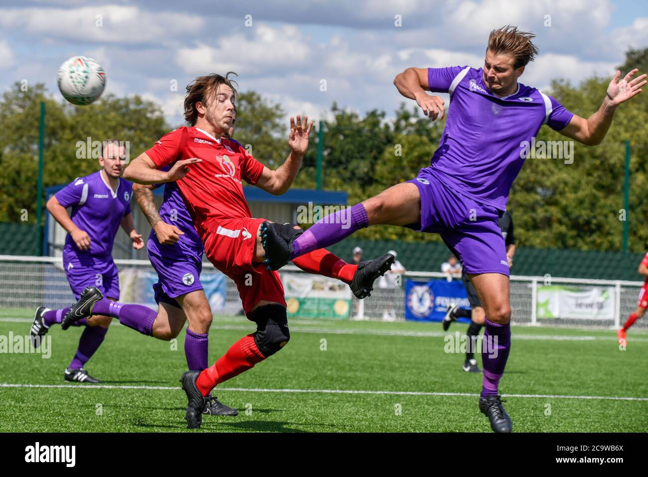 parkside-football-ground-aveley-essex-uk-2nd-aug-2020-with-the-clearance-given-for-team-sports-to-recommence-after-the-covid-19-coronavirus-lockdown-the-teams-in-the-uk-are-beginning-friendly-matches-in-front-of-small-crowds-in-preparation-for-competitive-matches-in-september-the-alex-rungay-memorial-cup-took-place-at-aveleys-ground-and-saw-four-sunday-league-teams-compete-for-the-trophy-in-memory-of-alex-who-passed-away-when-manager-of-fc-utd-of-hornchurch-one-of-the-teams-competing-red-team-v-acd-utd-in-purple-with-money-going-to-mind-charity-2C9WB6X.jpg