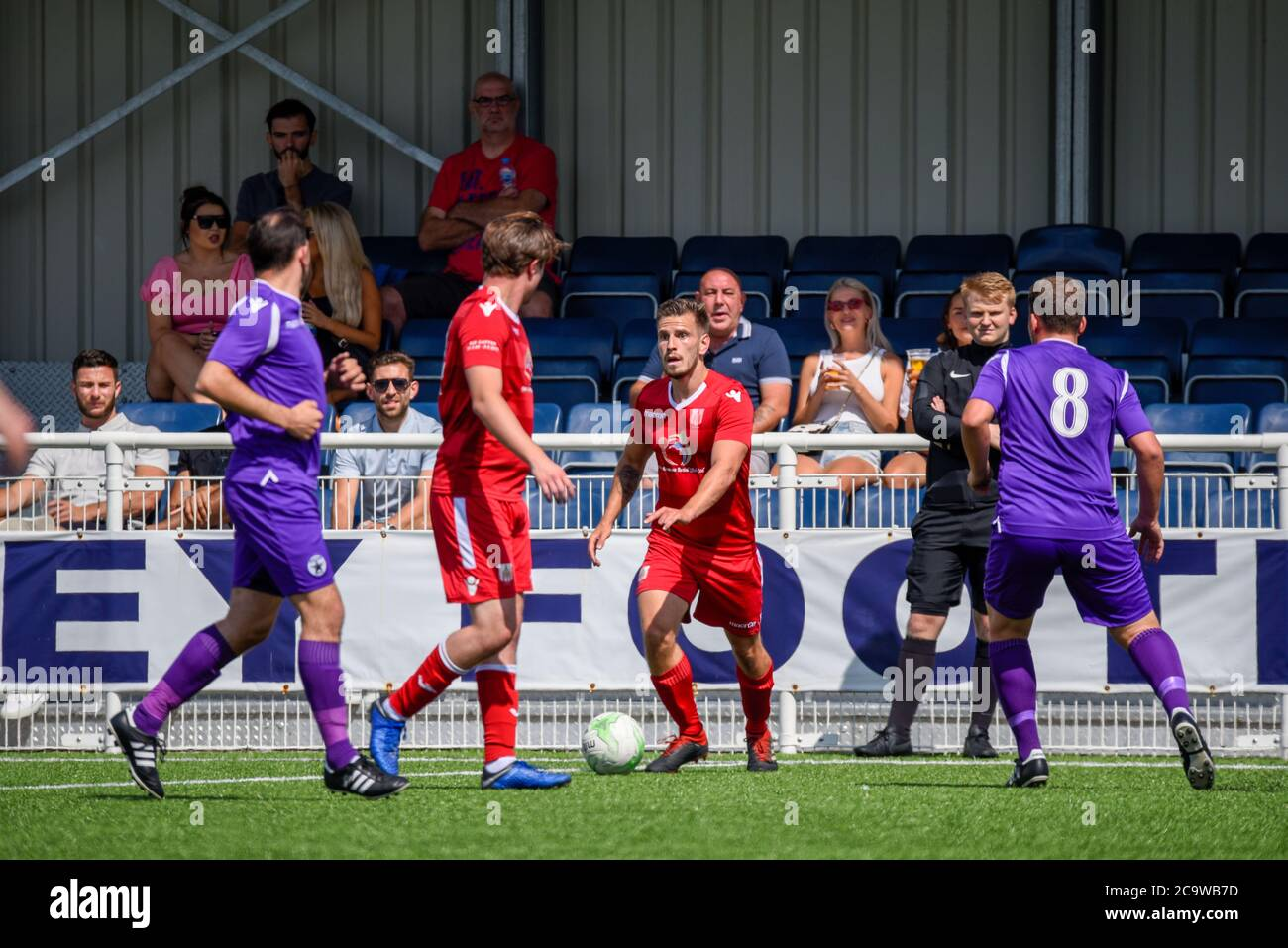 parkside-football-ground-aveley-essex-uk-2nd-aug-2020-with-the-clearance-given-for-team-sports-to-recommence-after-the-covid-19-coronavirus-lockdown-the-teams-in-the-uk-are-beginning-friendly-matches-in-front-of-small-crowds-in-preparation-for-competitive-matches-in-september-the-alex-rungay-memorial-cup-took-place-at-aveleys-ground-and-saw-four-sunday-league-teams-compete-for-the-trophy-in-memory-of-alex-who-passed-away-when-manager-of-fc-utd-of-hornchurch-one-of-the-teams-competing-red-team-v-acd-utd-in-purple-with-money-going-to-mind-charity-2C9WB7D.jpg