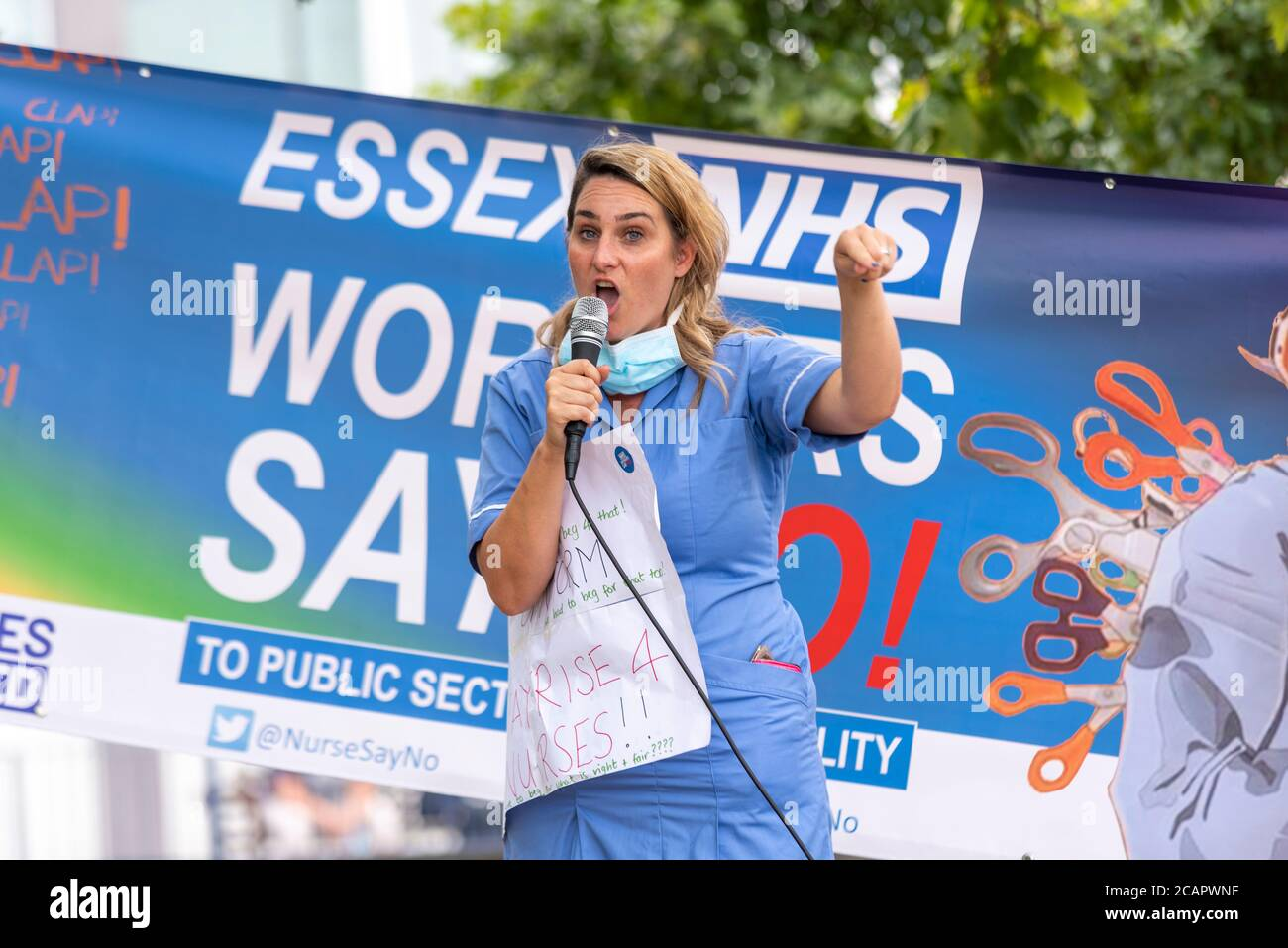 basildon-essex-uk-8th-aug-2020-a-demonstration-march-has-taken-place-in-basildon-protesting-against-the-exclusion-of-national-health-service-staff-from-the-public-sector-pay-increase-protesters-gathered-at-basildon-hospital-before-marching-into-basildon-town-centre-where-many-placed-flowers-and-ribbon-tributes-for-the-many-healthcare-workers-lost-to-the-covid-19-coronavirus-pandemic-a-nurse-from-southend-hospital-tells-of-the-harsh-conditions-and-lack-of-ppe-during-the-pandemic-2CAPWNF.jpg