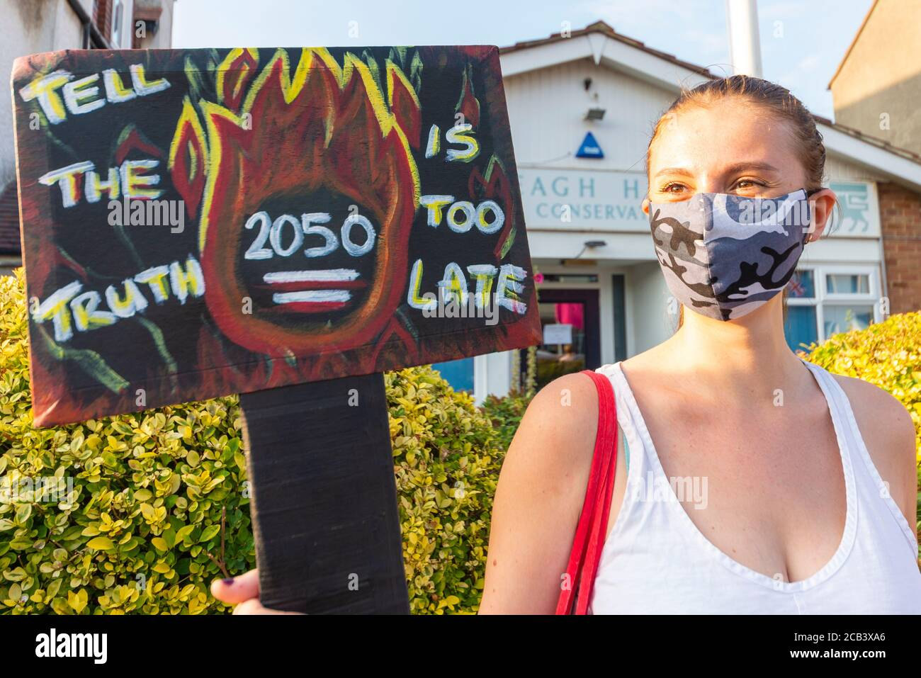 leigh-road-leigh-on-sea-essex-uk-10th-aug-2020-the-southend-branch-of-extinction-rebellion-held-a-protest-outside-the-iveagh-hall-constituency-office-of-david-amess-conservative-mp-for-southend-west-the-climate-change-protesters-held-a-banner-stating-tell-the-truth-in-relation-to-the-uks-target-of-reaching-net-zero-emissions-by-2050-which-they-believe-is-too-late-noaa-have-forecast-a-blue-ocean-event-of-melting-arctic-ice-2CB3XA6.jpg