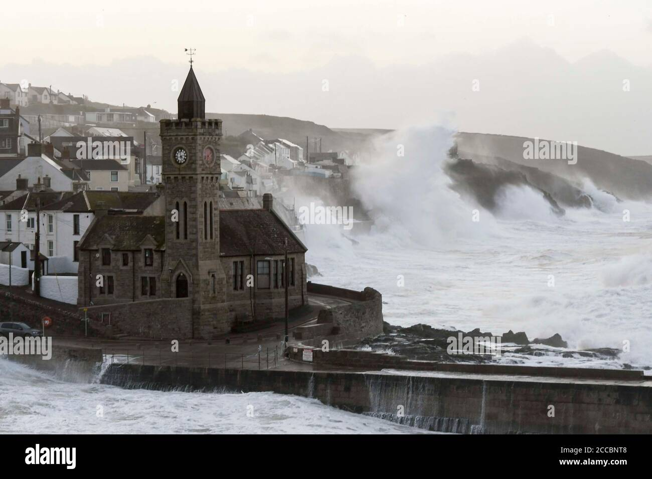 Porthleven, Cornwall, UK.  21st August 2020.  UK Weather.  Huge waves from Storm Ellen smash into the cliffs and coastal defences at Porthleven in Cornwall at sunrise during high tide on a morning of gale force winds from Storm Ellen.  Picture Credit: Graham Hunt/Alamy Live News Stock Photo