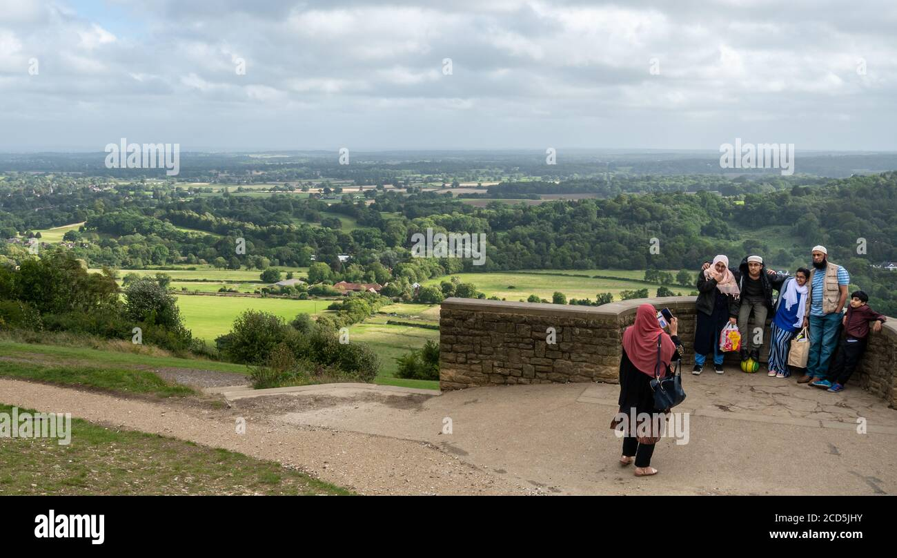 muslim-family-taking-a-photograph-at-the-box-hill-viewpoint-in-the-surrey-hills-area-of-outstanding-natural-beauty-uk-2CD5JHY.jpg