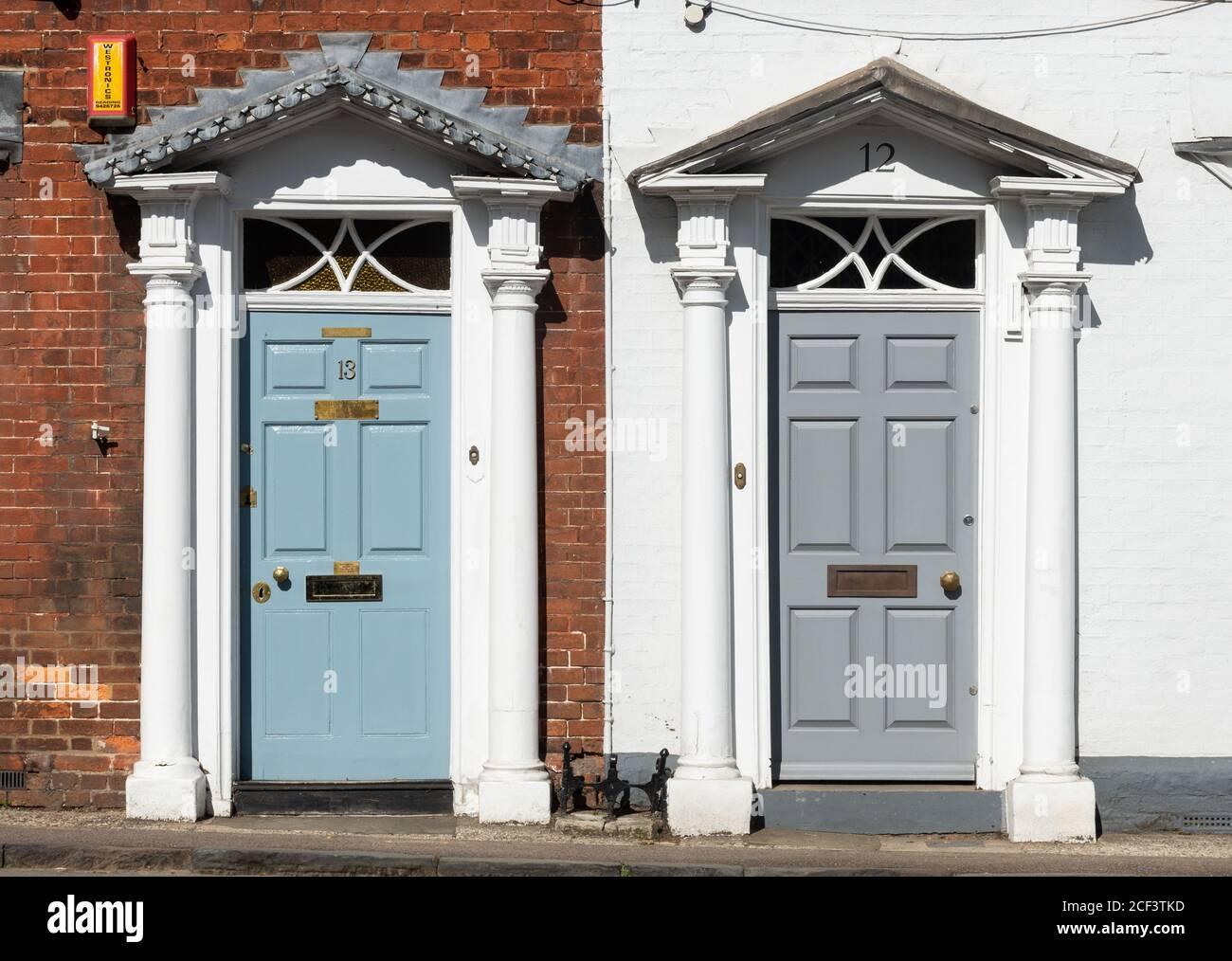 two-adjacent-ornate-front-doors-with-columns-2CF3TKD.jpg