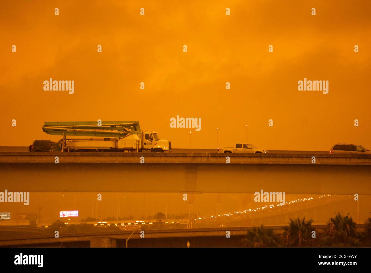 September 9, 2019. Traffic on Highway 80 and San Francisco Bay Bridge and toll booth during freak afternoon orange sky from toxic smoke of wildfires. Stock Photo