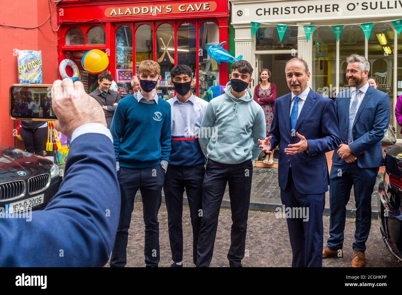 clonakilty-west-cork-ireland-11th-sep-2020-an-taoiseach-michel-martin-visited-the-office-of-party-colleague-and-new-td-christopher-osullivan-this-afternoon-in-ashe-street-clonakilty-schoolboys-ben-reilly-harold-paulino-and-adam-kelly-from-clonakilty-community-college-persuaded-the-taoiseach-to-make-a-video-explaining-to-their-teacher-why-they-were-going-to-be-late-back-to-school-credit-ag-newsalamy-live-news-2CGHKFP.jpg