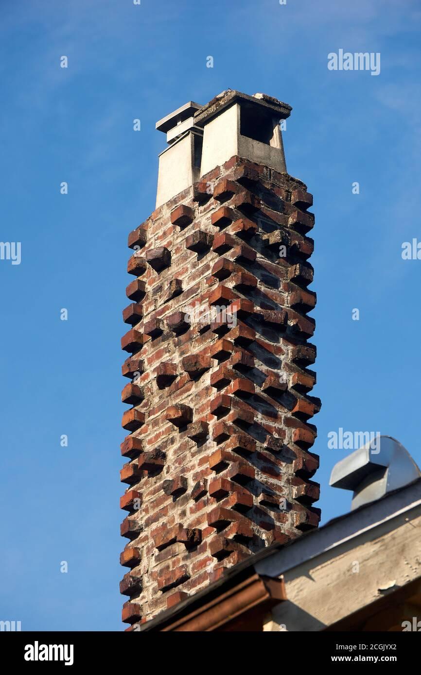 red-brick-masonry-chimney-on-the-roof-of