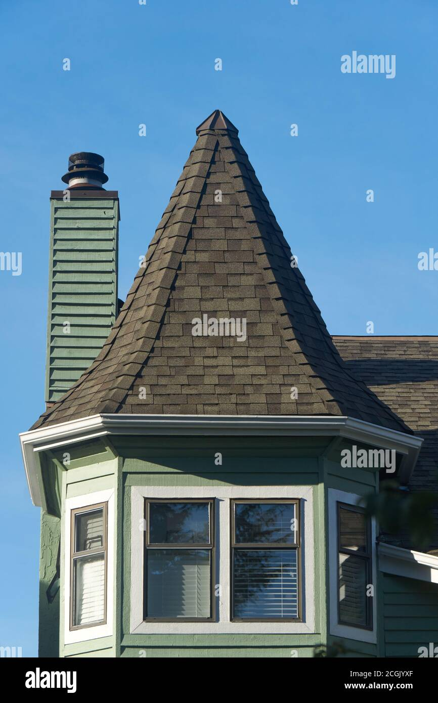 decorative-steep-sided-peaked-roof-of-a-