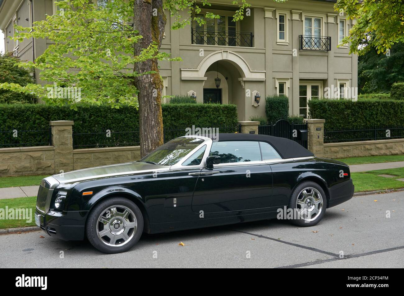 black-rolls-royce-convertible-parked-out