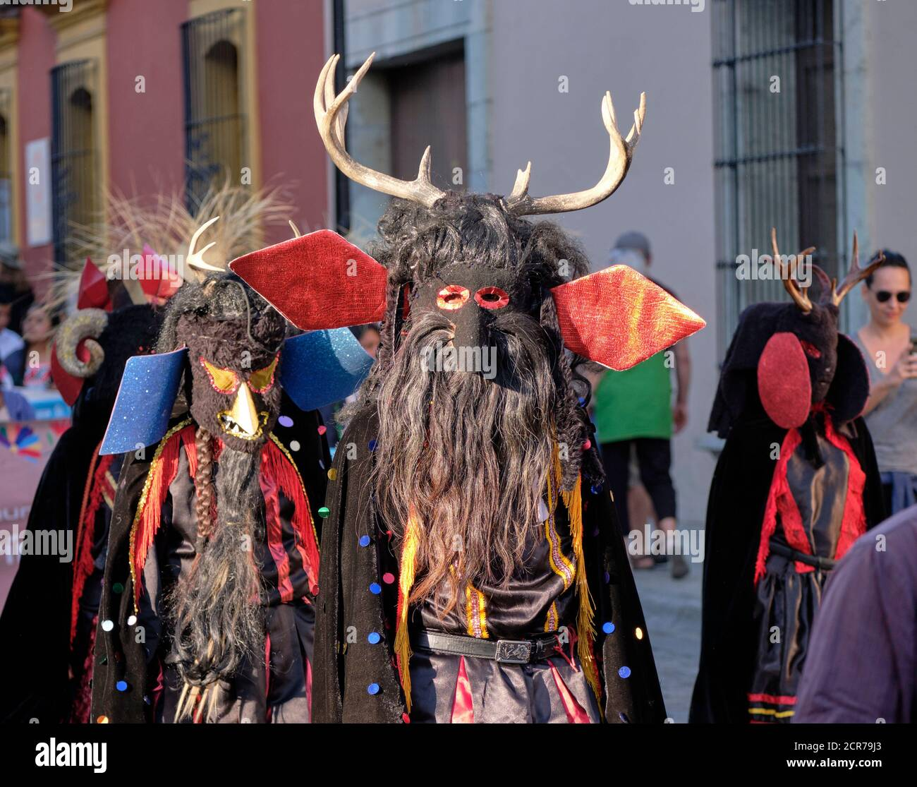 Portrait of Mexican Devil creature with antlers walking in a parade in Street of Oaxaca Stock Photo