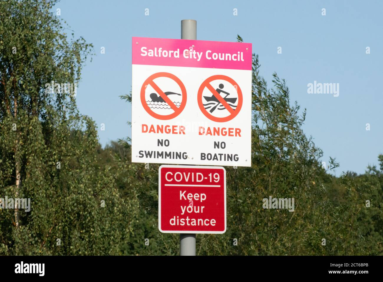 Salford City Council no swimming no boating sign, with COVID-19 keep your distance red sign, Clifton Country Park, England UK, coronavirus Stock Photo