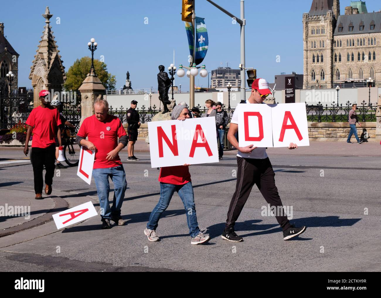 protesters-in-front-of-canadian-parliament-with-letter-to-spell-canada-where-one-protester-drops-his-letters-on-pavement-part-of-protest-message-thro-2CTKH9R.jpg