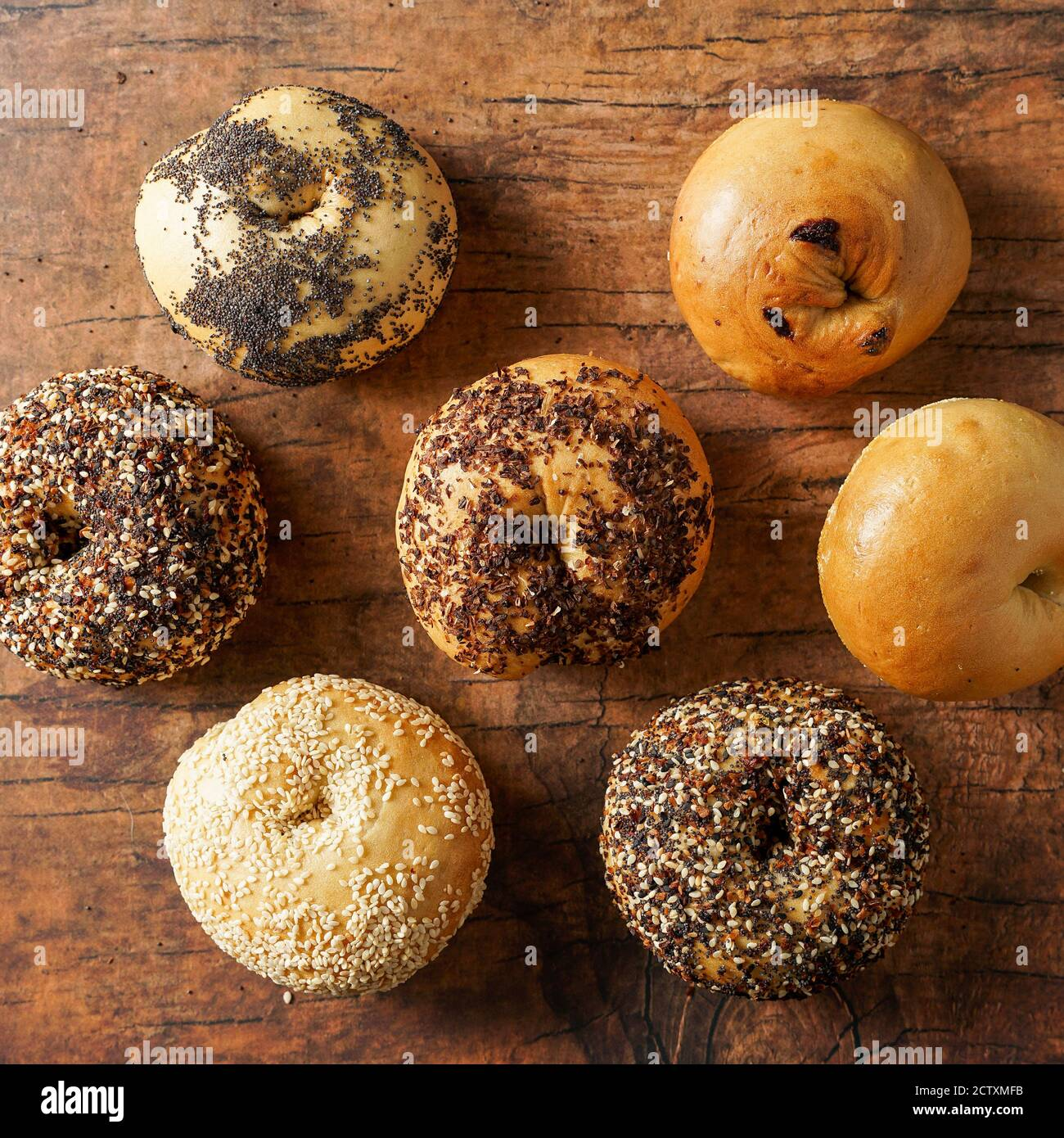 Fresh Sourdough Bagels on a wooden surface Stock Photo