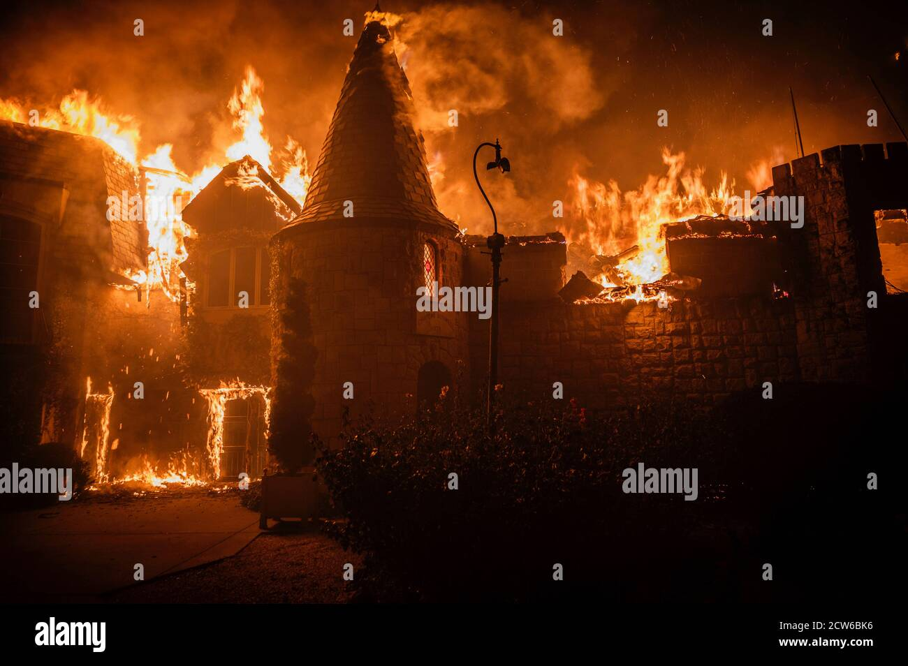 California, USA. 27th Sep, 2020. The Chateau Boswell winery goes up in flames as the Glass Fire burns along the Silverado Trail near St. Helena in the Napa Valley on Sunday night, Sept. 27, 2020. Credit: Daniel Kim/Sacramento Bee/ZUMA Wire/Alamy Live News Stock Photo