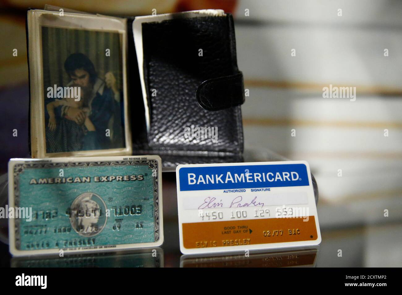 """Elvis' wallet with a picture of himself and daughter Lisa-Marie and signed credit cards are pictured at the """"Elvis at the O2 : The Exhibition of His Life - Direct from Graceland"""" exhibition at the O2 Arean in London December 11, 2014.  The nine month exhibition is the largest retrospective to have ever been presented in Europe and opens Friday.  REUTERS/Luke MacGregor  (BRITAIN - Tags: ENTERTAINMENT SOCIETY) Stock Photo"""