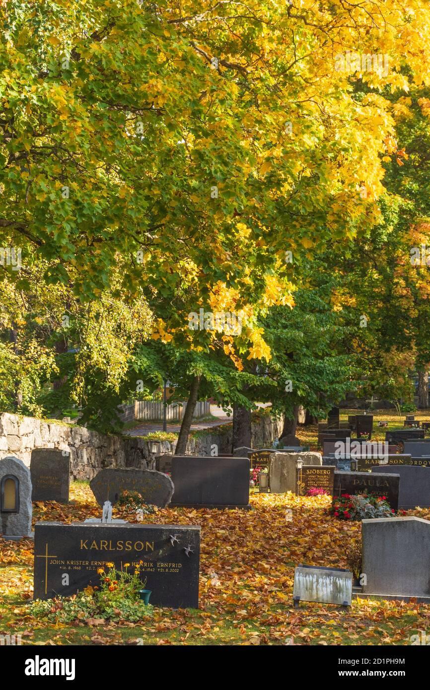 Nauvo island churchyard in autumnal colours on Nauvo island Finland Stock Photo