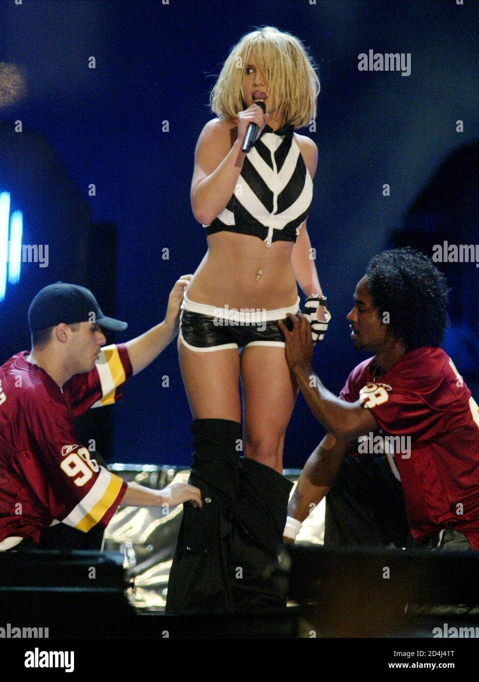 Entertainer Britney Spears performs on the National Mall during the 2003 NFL Kickoff Live concert in Washington, D.C., on September 4, 2003. PHOTO TAKEN SEPTEMBER 4 REUTERS/Molly Riley  MR/GAC Stock Photo