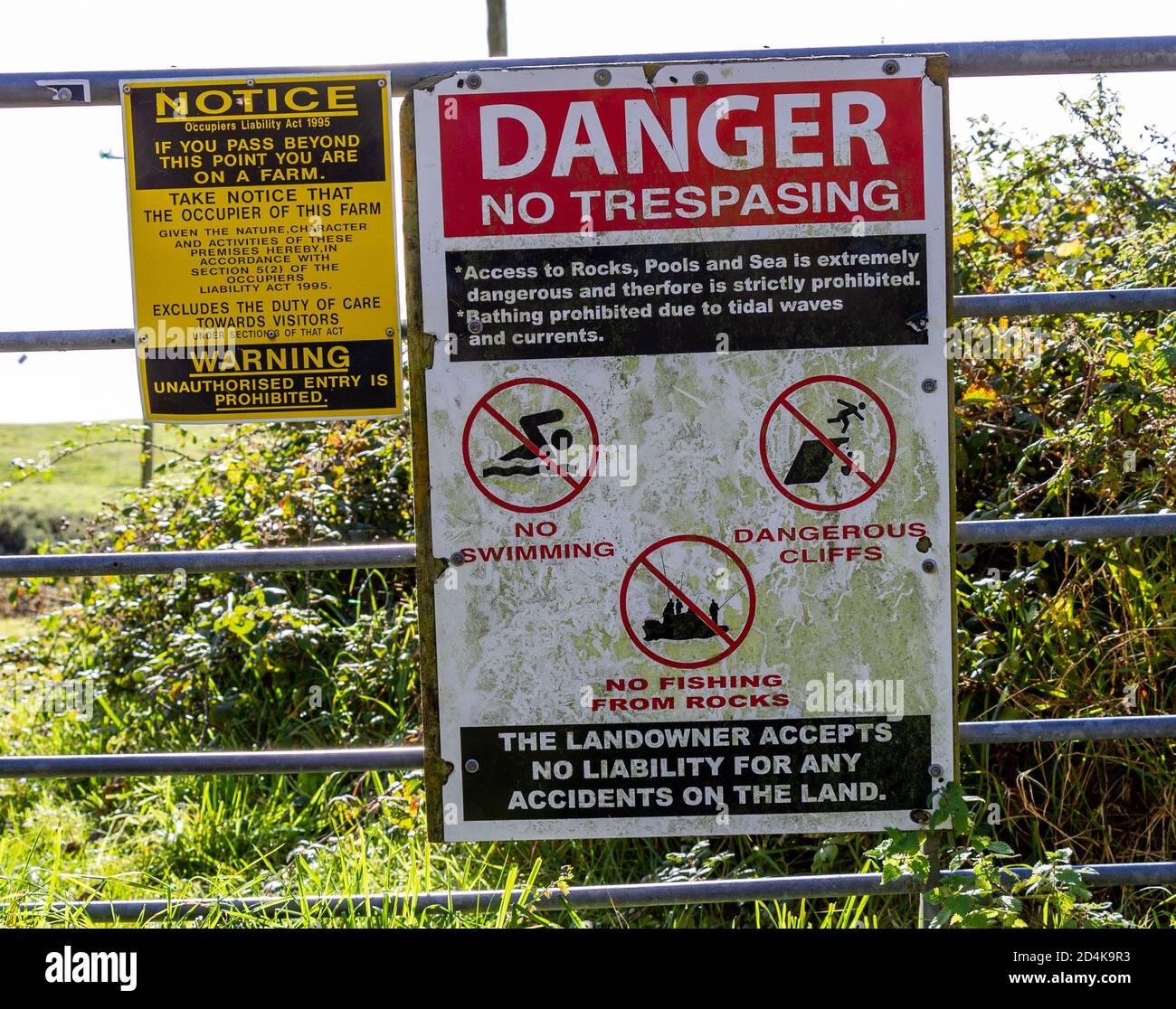 warning-no-trespassing-sign-on-farm-gate-2D4K9R3.jpg