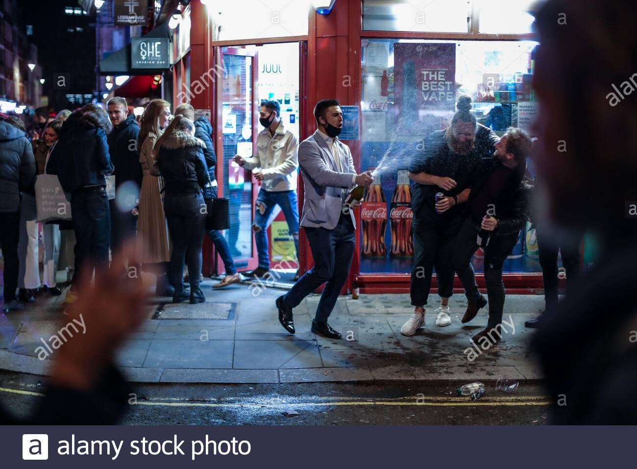 London, Britain. 9th Oct 2020. People drinking outside a bar in Soho, London on Friday, Oct 9, 2020 -  ahead of the 10 pm curfew. Pubs and restaurants are subject to in order to curb the spread of coronavirus. Boris Johnson is to outline a new three-tiered system of coronavirus restrictions on Monday that is expected to cause pubs and restaurants to shut across the north of England. (VXP Photo/ Vudi Xhymshiti) Credit: VX Pictures/Alamy Live News Stock Photo