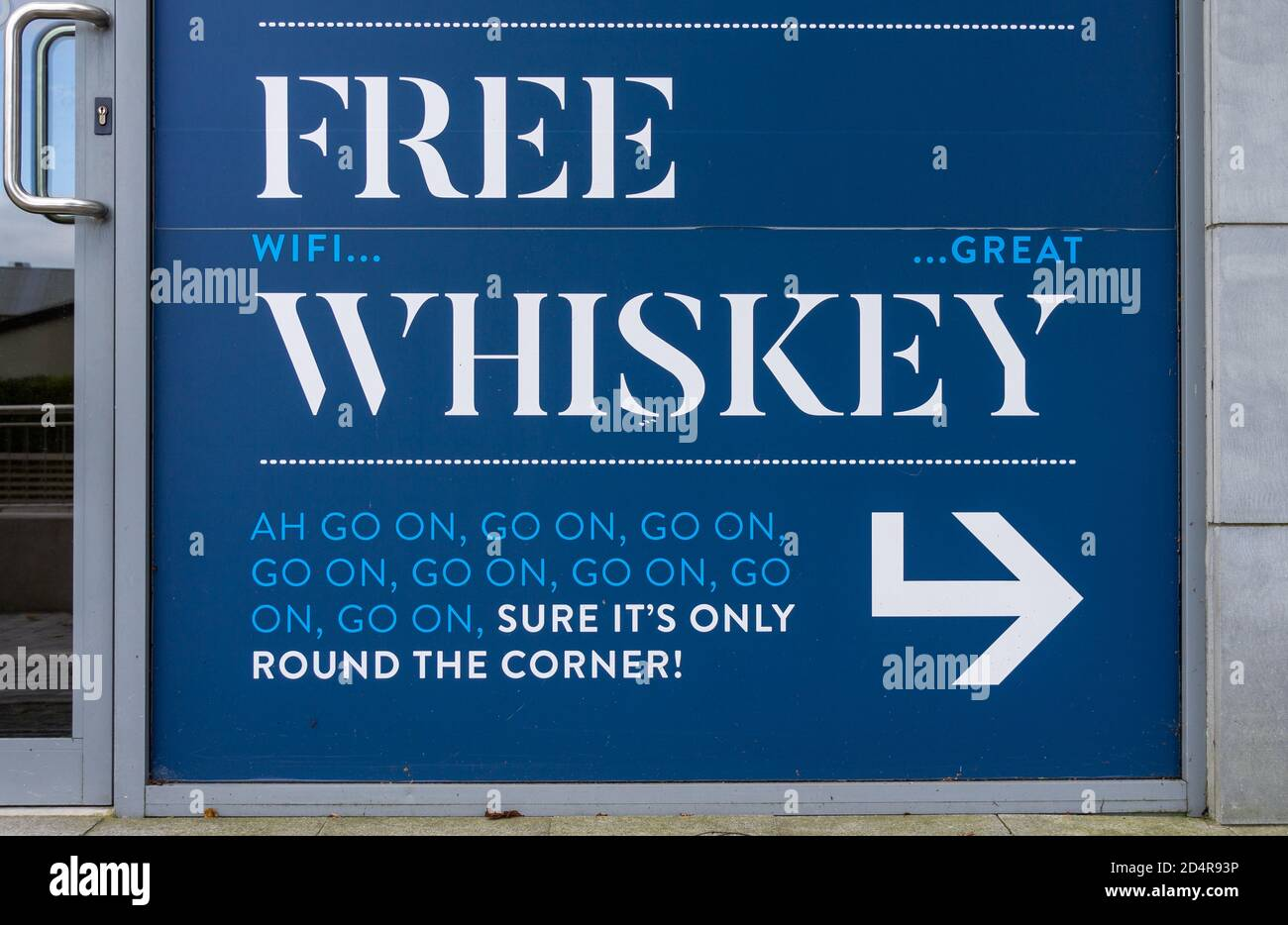 white-on-blue-sign-with-free-whiskey-spelled-out-2D4R93P.jpg