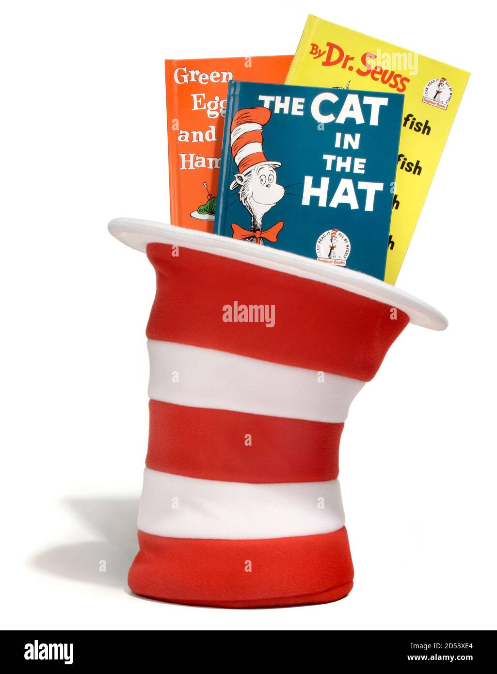 Dr. Seuss books in a red and white striped hat photographed on a white background Stock Photo