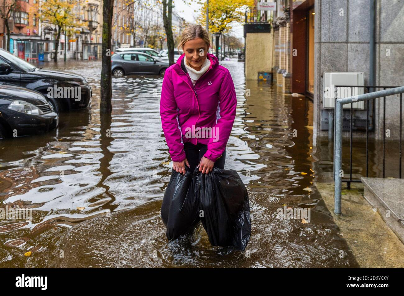 cork-ireland-20th-oct-2020-cork-city-flooded-this-morning-with-south-mall-and-the-low-lying-quays-bearing-the-brunt-of-the-flood-water-this-lady-used-bin-bags-to-protect-her-shoes-credit-ag-newsalamy-live-news-2D6YCXY.jpg
