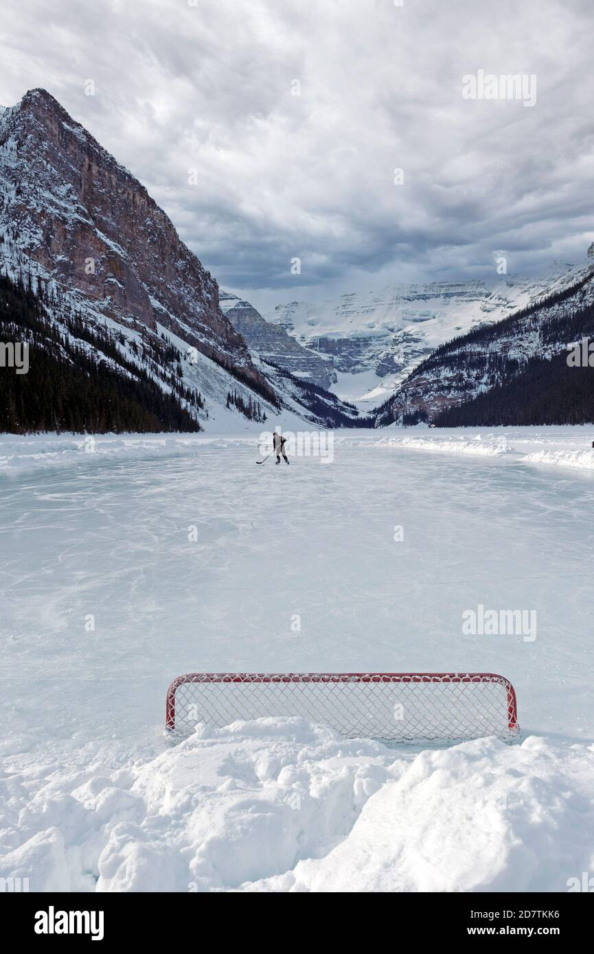 Hockey player on the frozen Lake Louise in Banff Alberta Canada Stock Photo