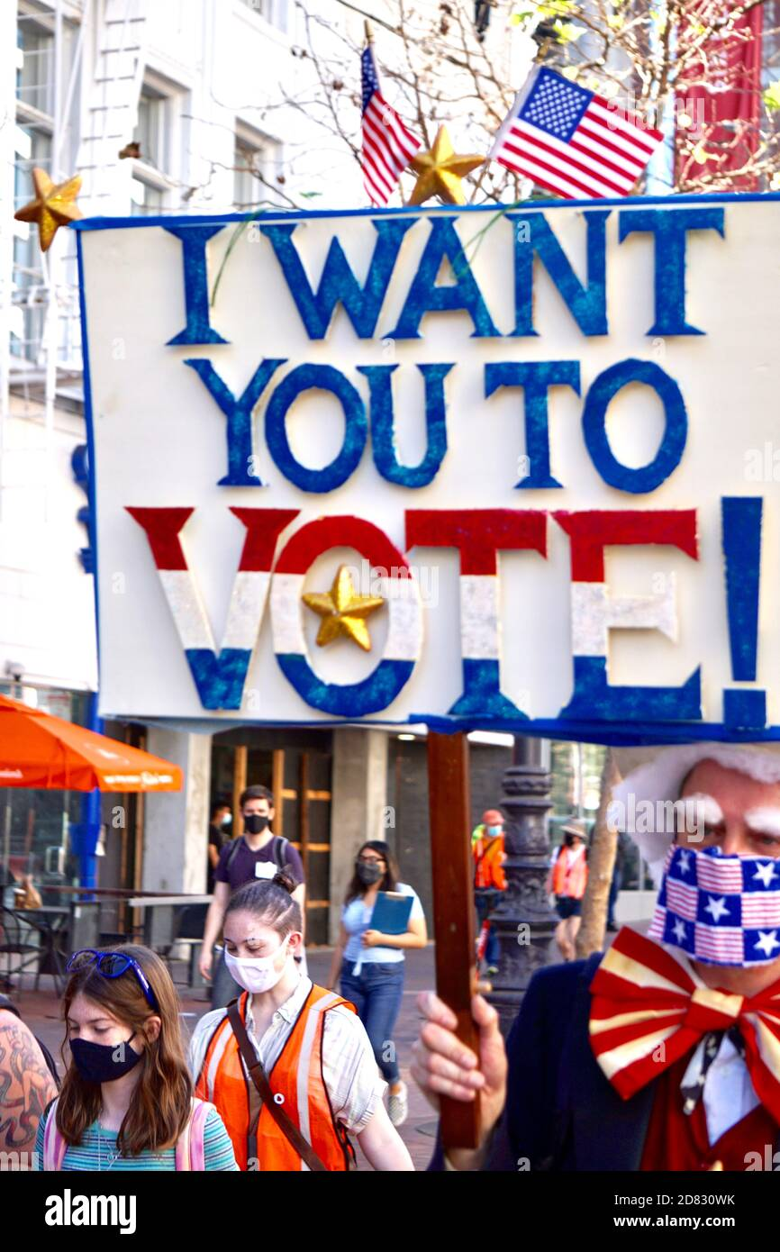 October 17, 2020. Protester dressed as Uncle Sam carries a Vote sign before the election on Market Street at the SF Women's March. San Francisco, CA. Stock Photo