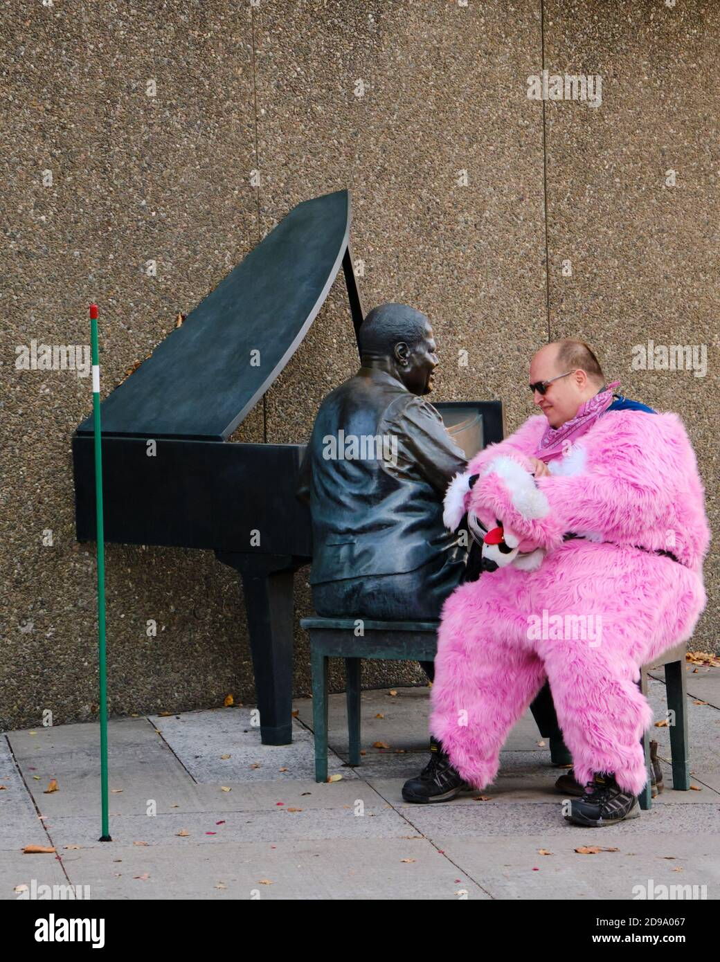 man-in-pink-animal-costume-with-the-head-removed-sitting-for-a-break-on-pianist-statue-in-ottawa-canada-2D9A067.jpg