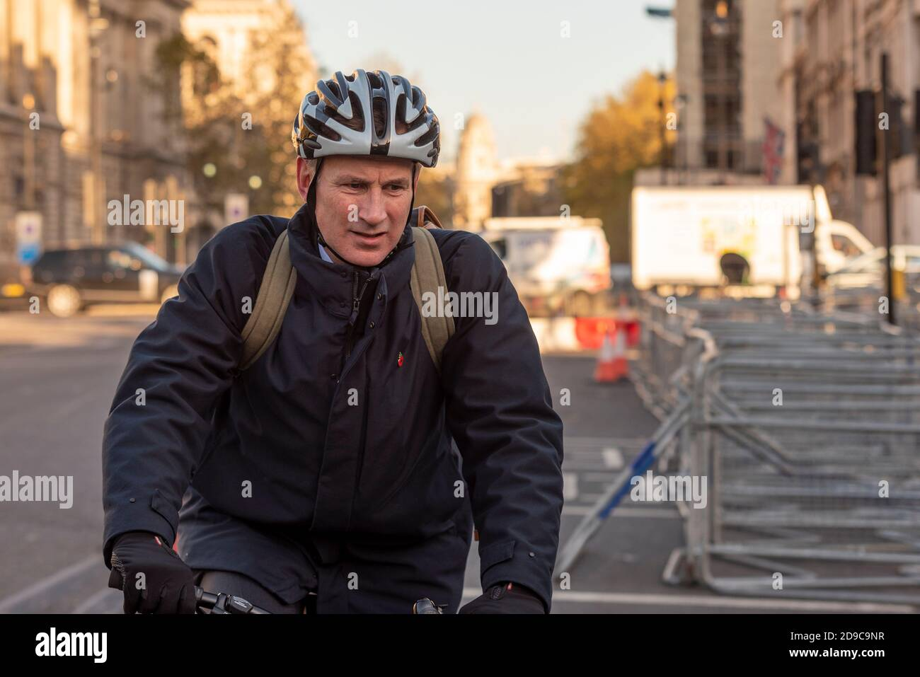 jeremy-hunt-mp-arriving-at-parliament-on-a-bicycle-on-the-day-of-the-vote-to-go-into-lockdown-2-tory-member-of-parliament-for-south-west-surrey-2D9C9NR.jpg