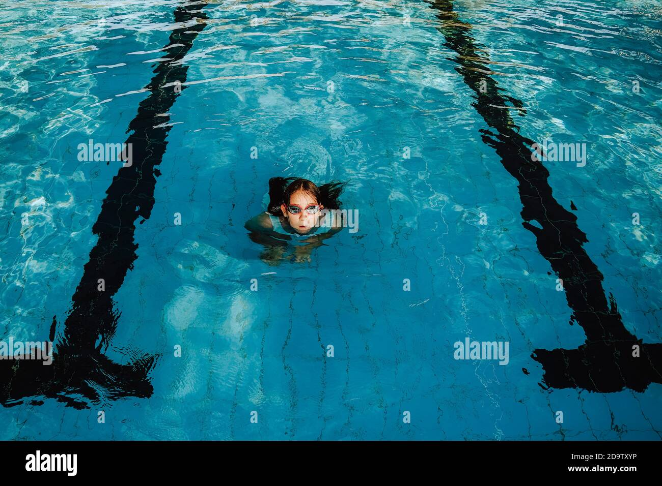 young-girl-wearing-swimming-goggles-in-a