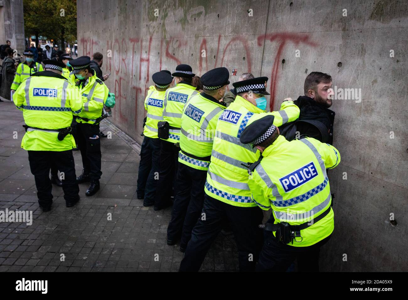 Manchester, UK. 08th Nov, 2020. A man is detained by the police during a anti-lockdown demonstration which was organised under the banner 'Rise Up Manchester'. New legislation was passed stopping protests of more than two people being able to protest at a time. Protests all across the country have been seen this weekend challenging the latest lockdown that was imposed on the country earlier in the week. Credit: Andy Barton/Alamy Live News Stock Photo