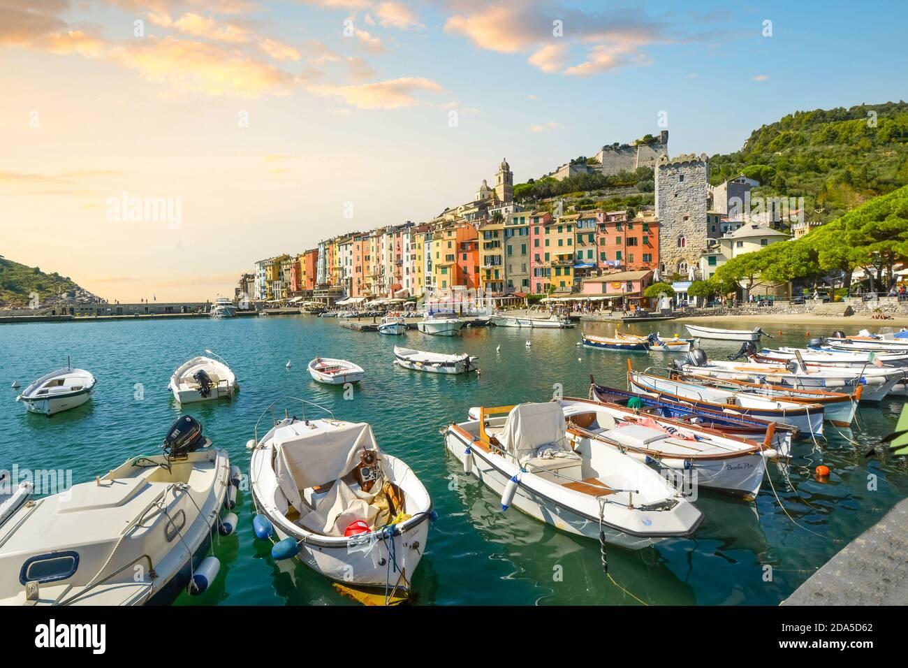 Boats line the harbor of the colorful, touristic Italian city of Portovenere, along the Ligurian Coast of the Italian Riviera. Stock Photo