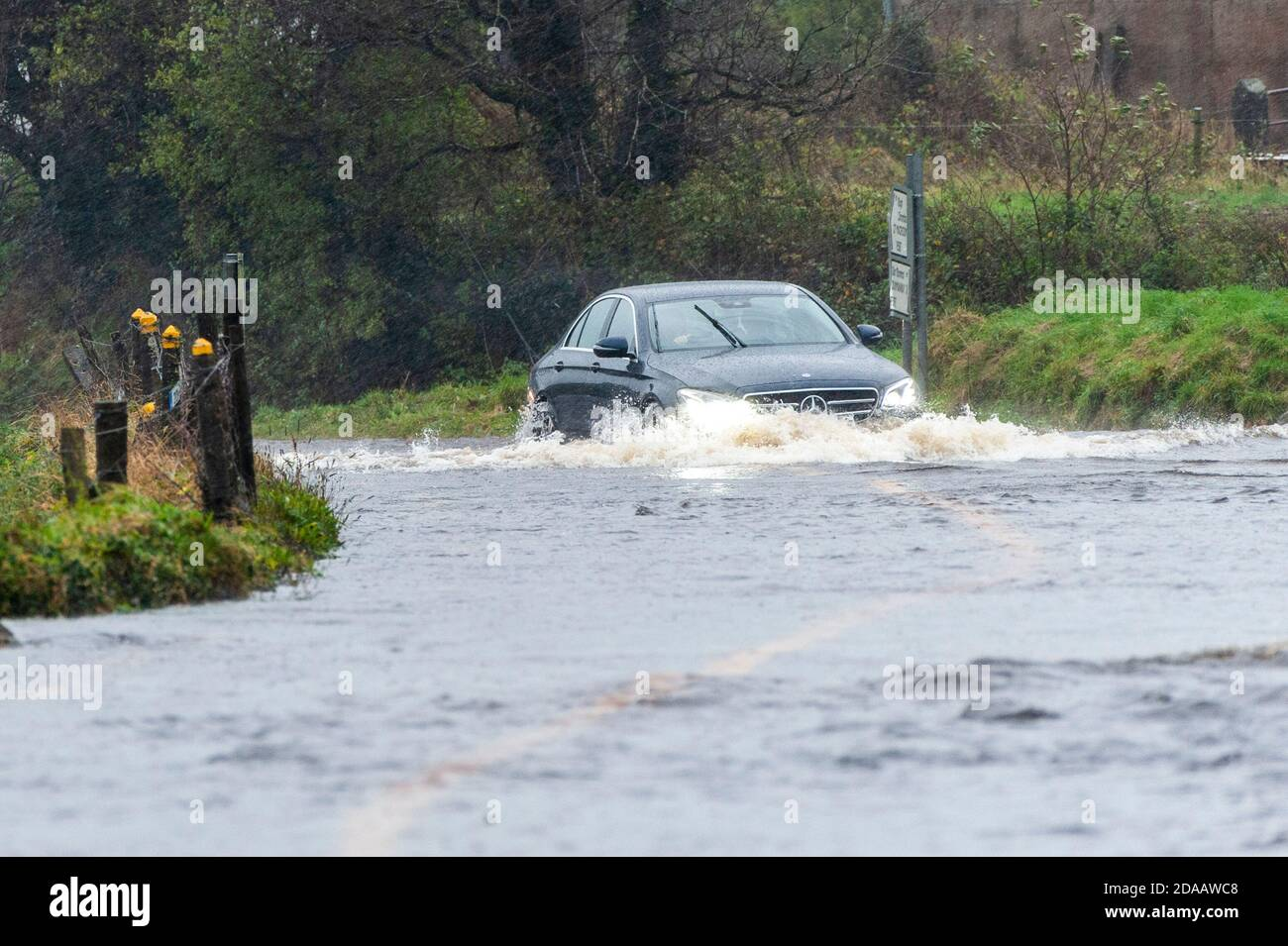 dunmanway-west-cork-ireland-11th-nov-2020-after-a-night-and-morning-of-torrential-rain-the-r587-flooded-just-outside-dunmanway-today-the-flooding-comes-in-the-midst-of-a-met-ireann-yellow-weather-warning-for-county-cork-which-is-in-place-until-6pm-this-evening-credit-ag-newsalamy-live-news-2DAAWC8.jpg
