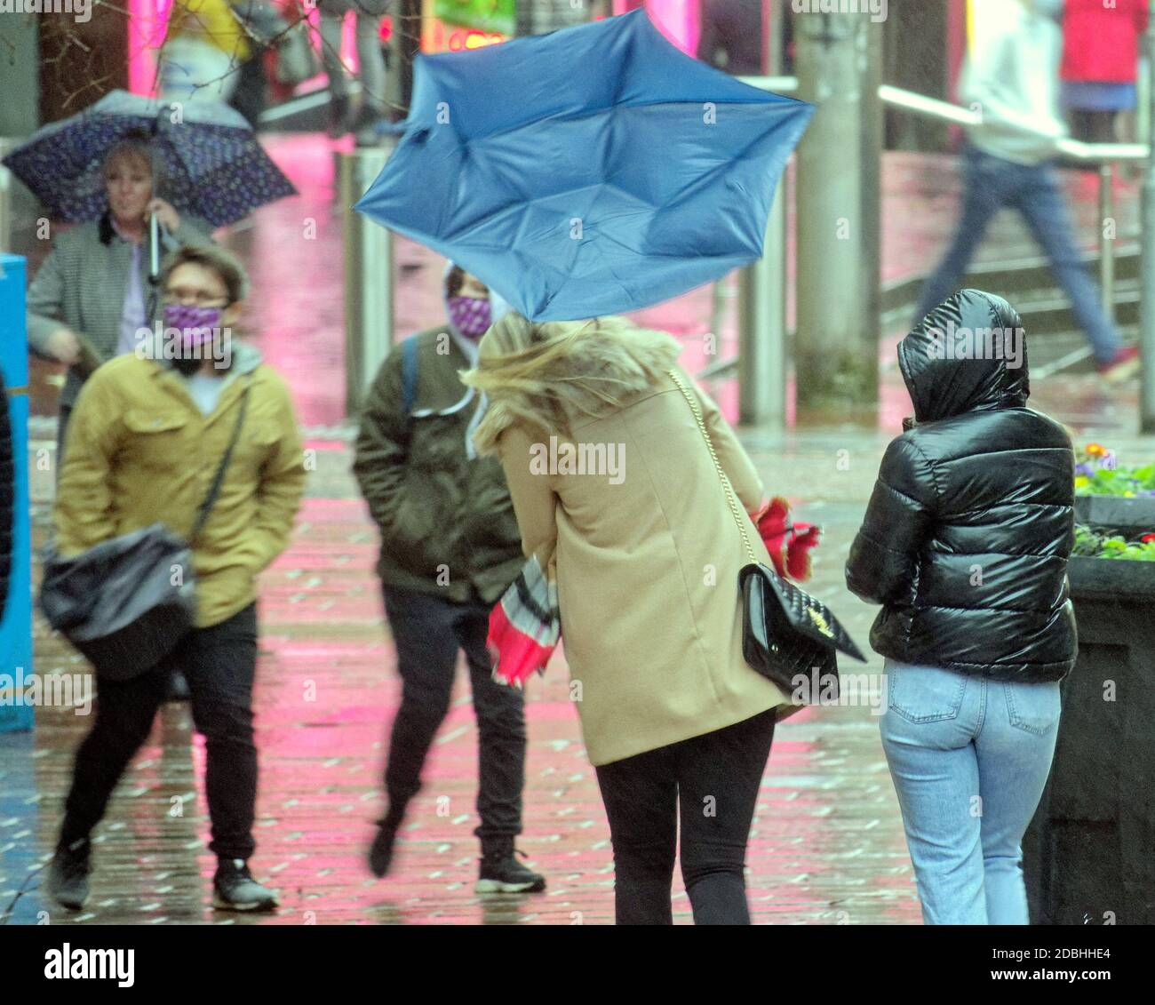 Glasgow, Scotland, UK. 17th November, 2020: UK Weather:  Rain and the threat of tier 4 added to the misery of locals as umbrellas and face masks were the hallmarks of the misery. Credit: Gerard Ferry/Alamy Live News Stock Photo