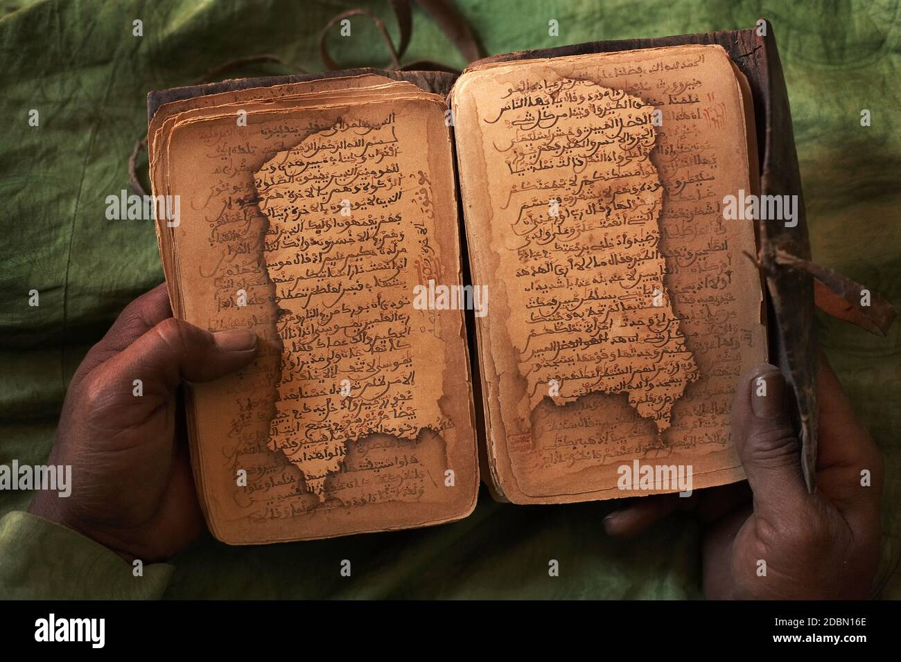 Bularaf holding a Islamic Medical Manuscript  from 16th century. Stock Photo