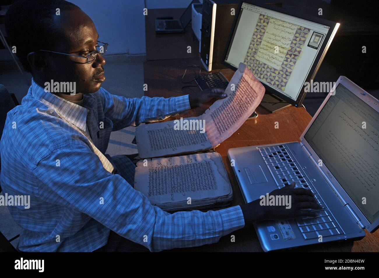 Ahmed-Baba-Institute The manuscrips getting digitalised.It can take as long as 45 days to copy a large document.Timbuktu, Mali, West Africa Stock Photo