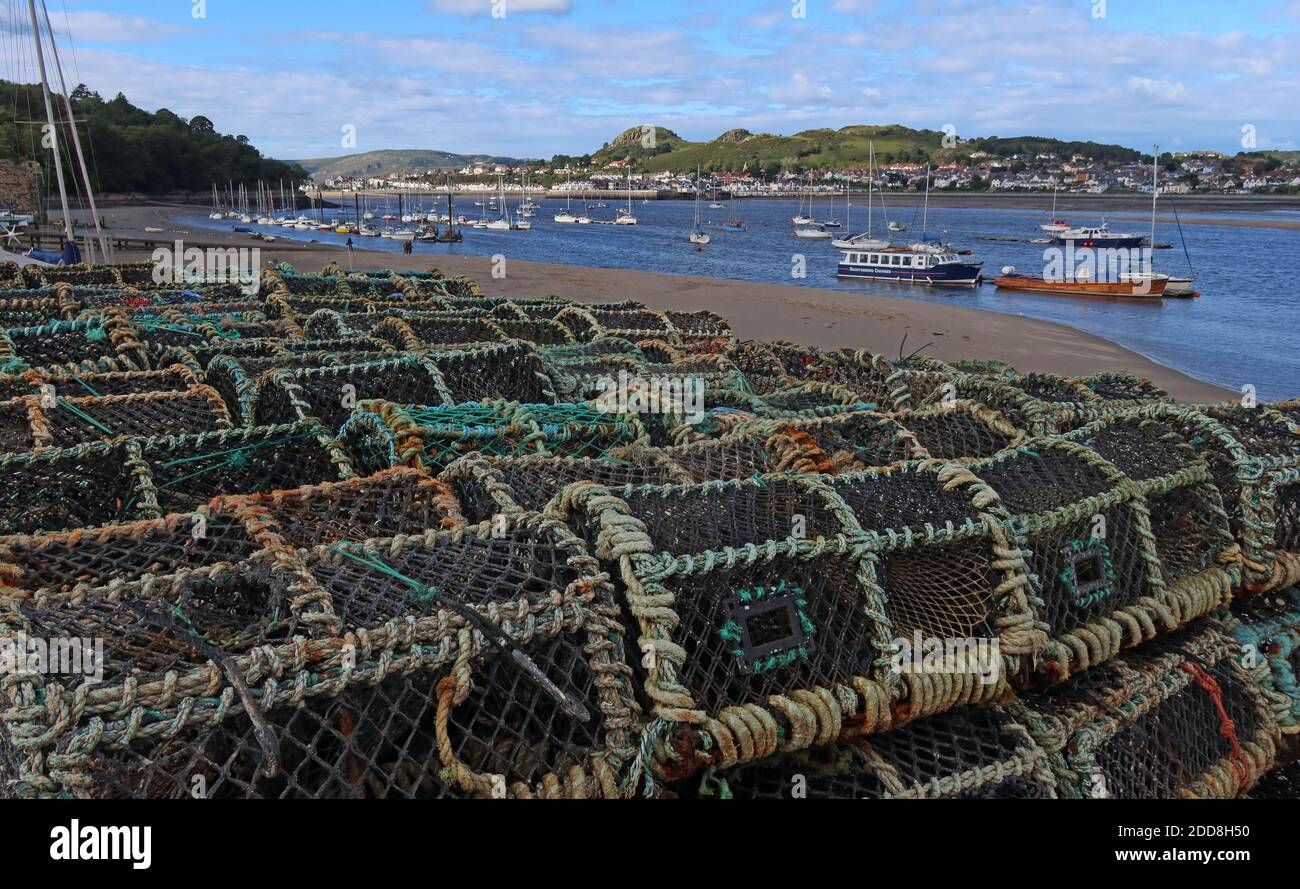 GoTonySmith,Hotpixuk,@Hotpixuk,North Wales,Wales,Welsh,coast,coastal,town,Gwynedd,Conway,River Conwy Quay,UK,tourist,tourism,LL32,for a living,livelihood,threat,threatened,Brexit,opportunity,Lobster pots,on the harbourside,crabs,crabbing,idle,out of work,pot,pots,sea side,sea,seaside,crab pots,large stack,stack,stacked,Lobster trap,creel
