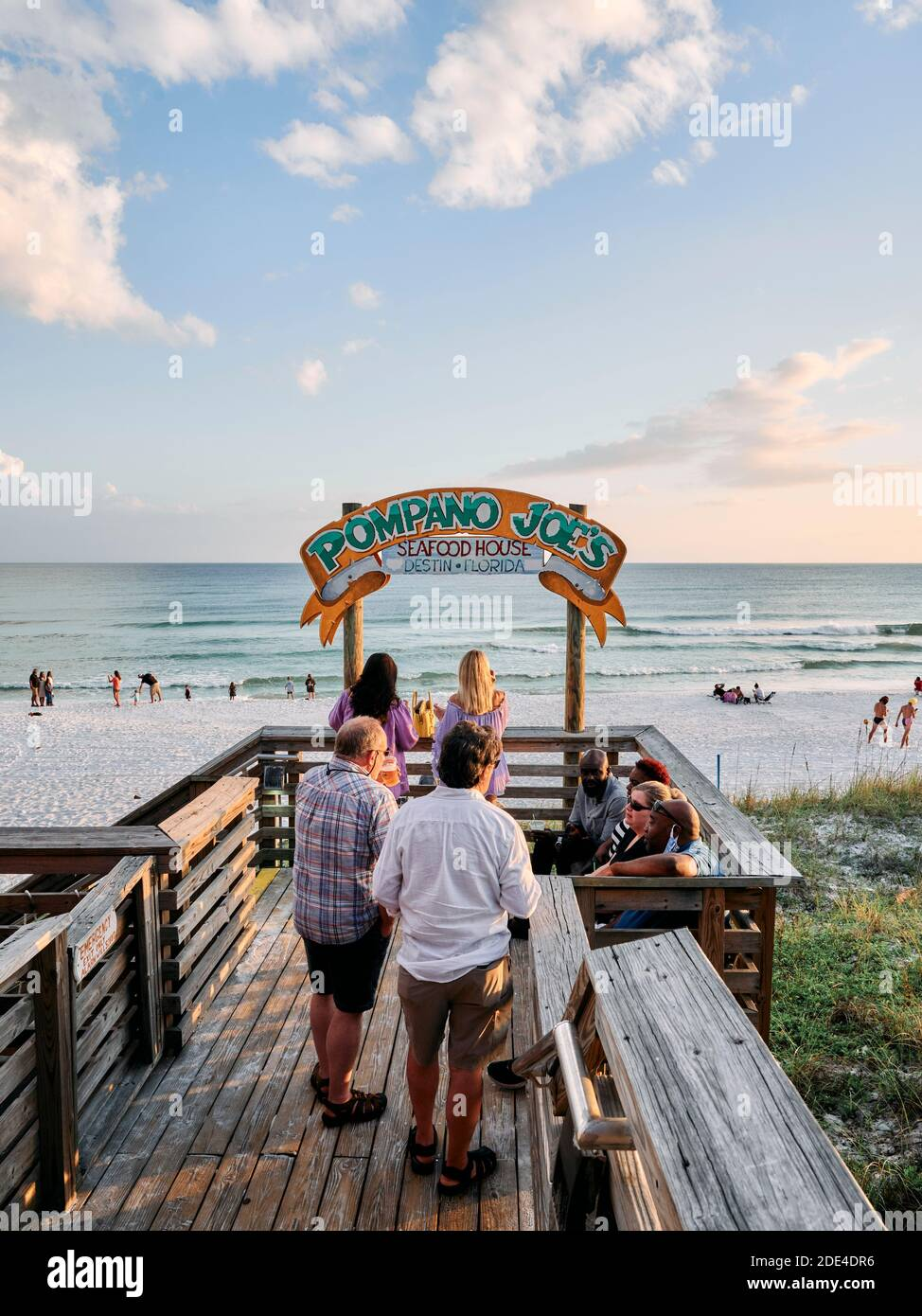 People relaxing on the deck of Pompano Joe's beach bar in south Walton County, in the Florida panhandle, Gulf Coast, Destin Florida, USA. Stock Photo