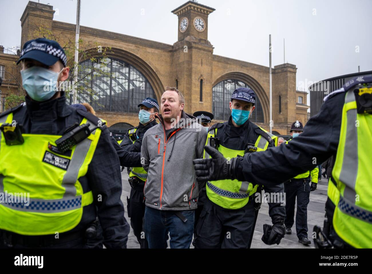 police-arresting-a-protester-outside-kings-cross-station-at-a-covid-19-coronavirus-anti-lockdown-protest-march-in-london-uk-for-being-outside-2DE7R5P.jpg