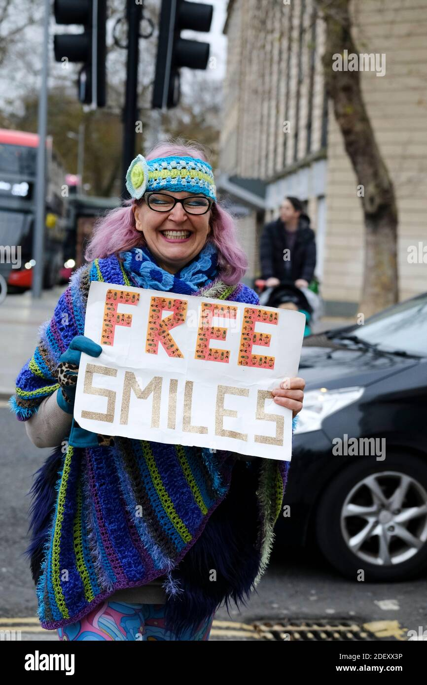 Bristol, UK. 2nd Dec, 2020. Non-essential shops are now open in tier 3 Bristol, bringing people into the city. Esther from Bistol is offering free smiles. Credit: JMF News/Alamy Live News Stock Photo