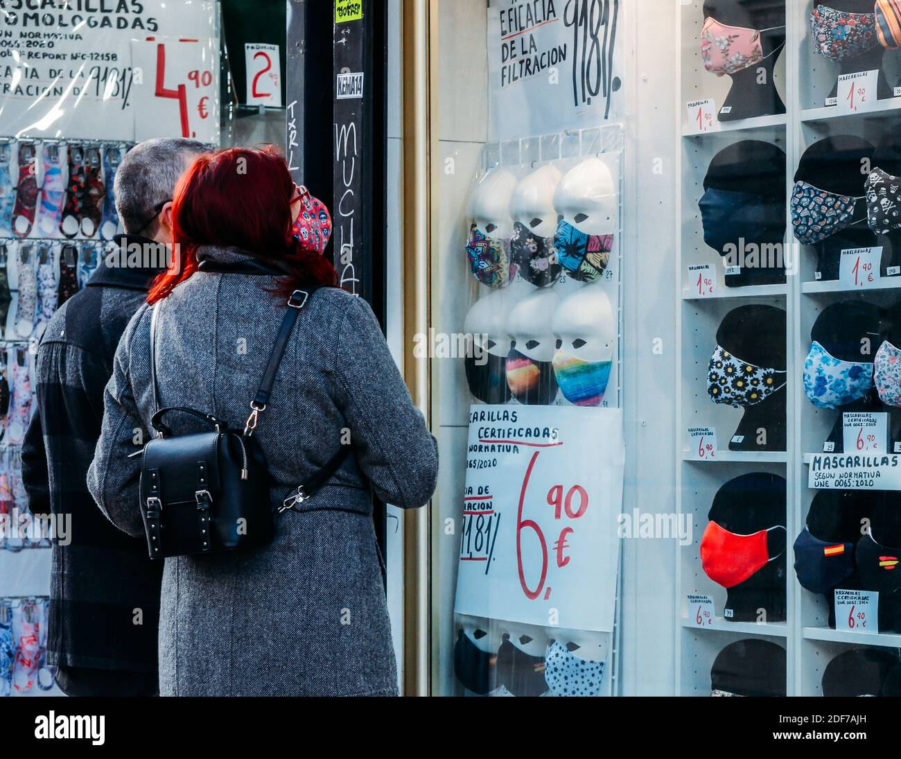 madrid-spain-november-29-2020-people-look-at-stylish-face-masks-on-display-for-sale-during-covid-19-epidemic-2DF7AJH.jpg