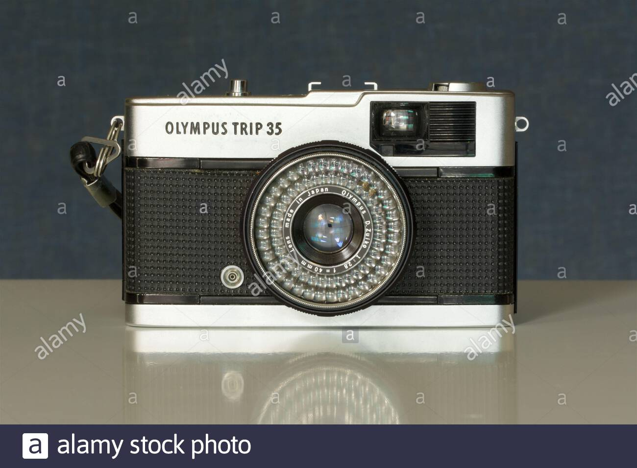 A 1972 model Olympus Trip 35, a fully automatic 35mm film camera. The light meter and automatic exposure system are solar-powered. Stock Photo