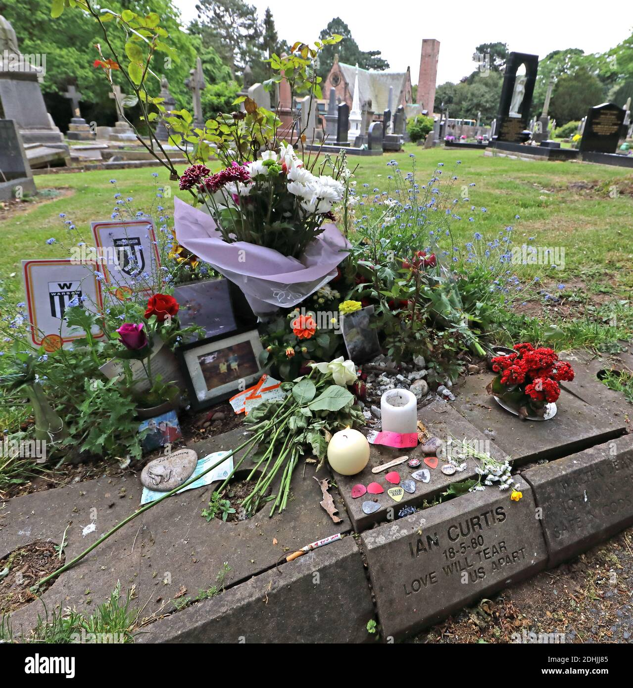 @HotpixUK,HotpixUK,GoTonySmith,grave stone,gravestone,18/05/1980,musicial,SK10,English,singer,songwriter,singer-songwriter,Factory,Factory label,song writer,flowers,pictures,cards,Love will tear us apart,logo,Unknown pleasures logo,plectrums,influences,influential,band,18-5-80,inscription,15 July 1956 – 18 May 1980,suicide,candle,candles,ticket,notes,paper,shrine,shes lost control,loveWillTearUsApart