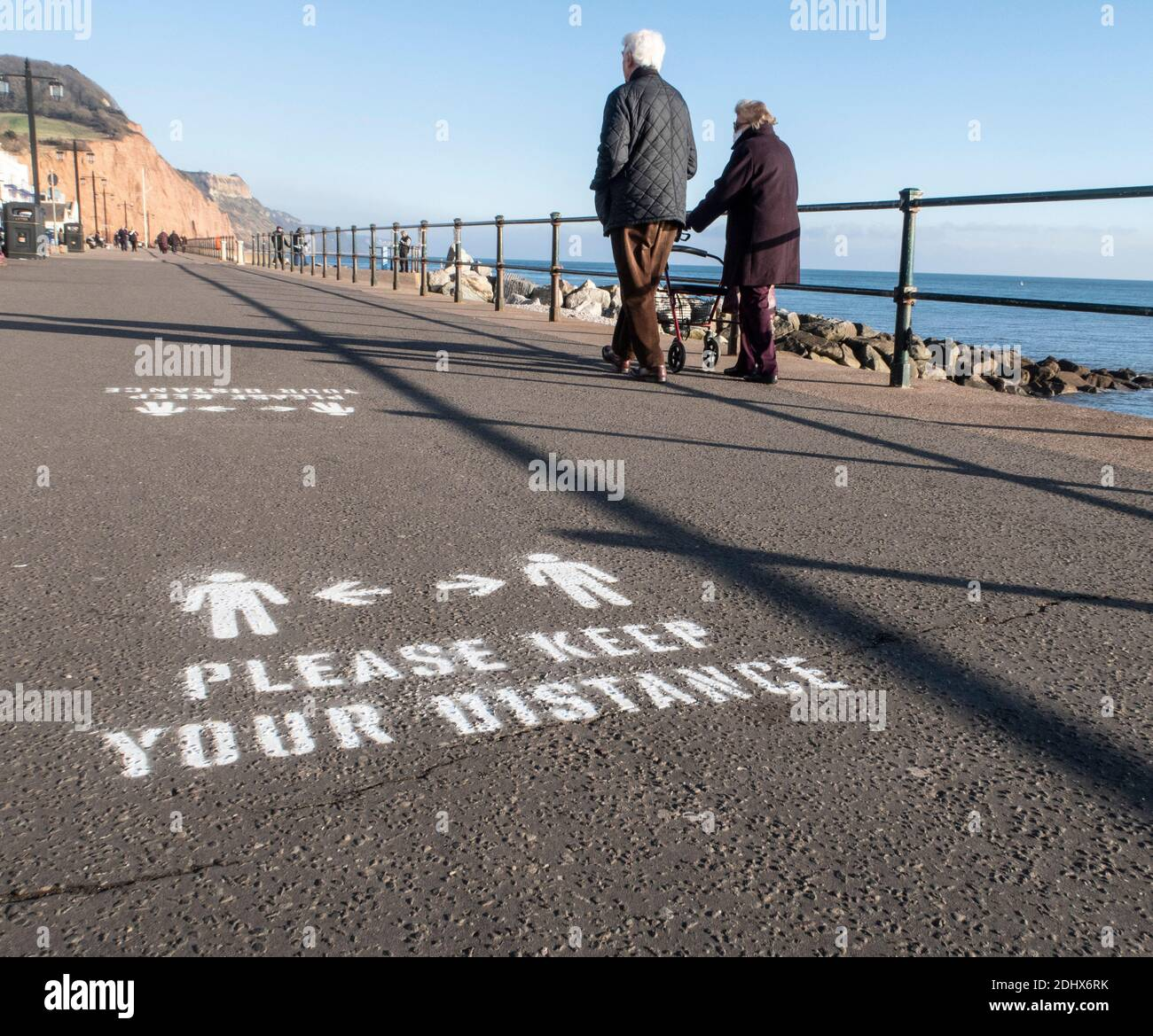 Keep your distance signs, social distancing, painted onto the Esplanade at Sidmouth, Devon, England, UK Stock Photo