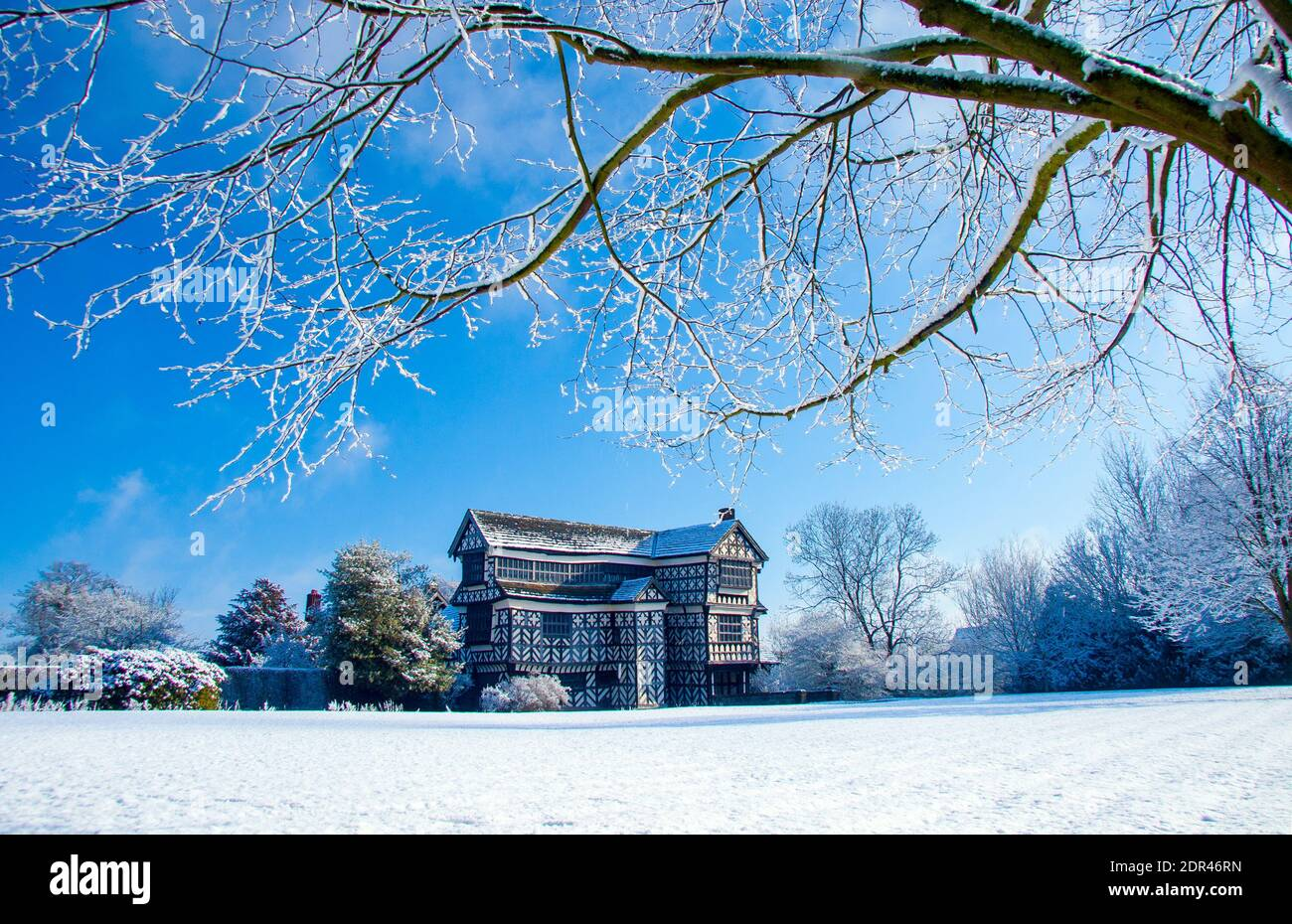 Little Moreton Hall a Tudor manor house owned by the National Trust  near Congleton Cheshire England in the snow as seen from the south Cheshire way Stock Photo