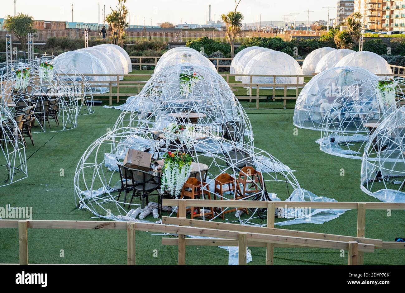 Brighton UK 27th December 2020 - The Igloo Village at the recently built Rockwater bar on Hove seafront are left damaged after Storm Bella passed through Britain last night  : Credit Simon Dack / Alamy Live News Stock Photo