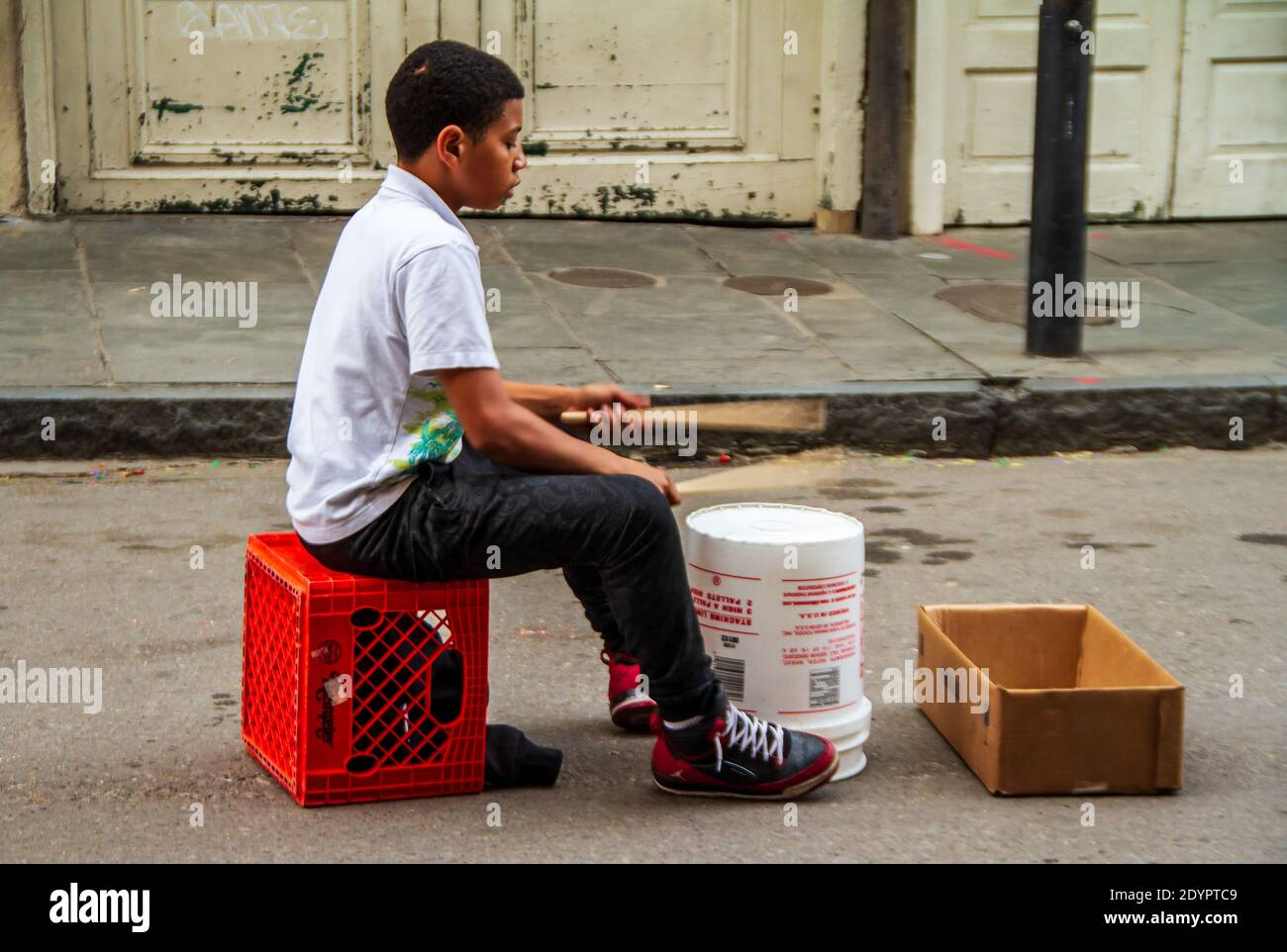 This young African American boy is an amazing drummer and street musician in the French Quarter of New Orleans, Louisiana, USA Stock Photo